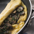 Mushroom Omelette folded in a Omelette Pan - Stock Photo