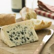 Wedge of Roquefort Cheese with Rustic Baguette and Red Wine — Stock Photo