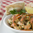 Dish of Garlic Buttered Tiger Prawns with Rustic Bread - Stock Photo