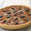 Stock Photo: Provencale Tart on Cooling Rack