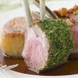 Rack of Lamb with a Herb Crust Potato Fondant and Ratatouille - Stock Photo