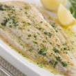 Whole Lemon Sole Meuniere with Lemon and Parsley Garnish — Photo