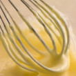 Hollandaise Sauce being whisked - Stock Photo