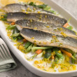 Fillets of Sebass with Baby Vegetables and Saffron Butter — Stock Photo #4765700