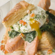 Seared Salmon Spinach and a Poached Egg in a Vol au Vent Case wi - Stock Photo