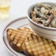 Fricassee of Frog Legs with Grilled Brioche - Stock Photo