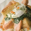Seared Salmon Spinach and a Poached Egg in a Vol-au-Vent Case wi - Stock Photo