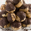 Chocolate Profiteroles on a Cake Stand - Stock Photo
