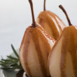 Pear Poached with Rosemary and a Chocolate sauce - Foto Stock