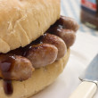 Pork Sausage Crusty Roll with Brown Sauce — Stock Photo