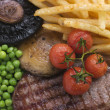 Foto Stock: Sirloin Steak Chips and Grill Garnish