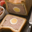 Stock Photo: Pork and Egg Gala Pie with Tomato Chutney