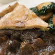 Game Pie with Fried Curly Kale and Potatoes — Stock Photo