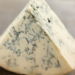 Wedge of English Stilton Cheese - Stock Photo