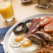 Royalty-Free Stock Photo: Full English Breakfast with Orange Juice Toast and Jam