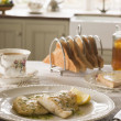 Royalty-Free Stock Photo: Smoked Haddock with Herb Butter and Toast