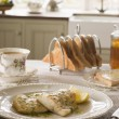 Smoked Haddock with Herb Butter and Toast - Stock Photo