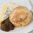 Cinnamon and Apple Scone with Stilton Cheddar and Chutney - Stock Photo