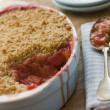Dish of Rhubarb and Blood Orange Crumble - Stock Photo