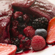 Traditional Summer Pudding with a scoop out - Stock Photo