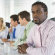 Foto Stock: Four businesspeople in boardroom