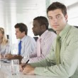 Four businesspeople in a boardroom — Stock Photo