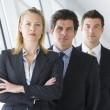 Three businesspeople standing in corridor — Stock Photo