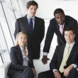 Four businesspeople in office lobby — Foto Stock