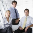 Three businesspeople sitting in office lobby — Foto Stock