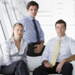 Three businesspeople sitting in office lobby — Stock Photo