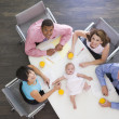 Four businesspeople in boardroom with a baby lying on the table — Stock Photo