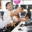 Five businesspeople in office space with a ball being thrown - Stock Photo