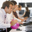 Businessman in office space with a ball — Stock Photo
