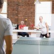 Stock Photo: Mand womin office space playing ping pong