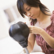 Woman in computer room sitting by small punching bag — Stock Photo