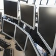 Empty office space with many monitors — Stock Photo