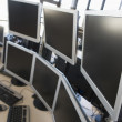 Stock Photo: Empty office space with many monitors