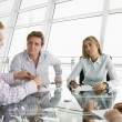 Stock Photo: Four businesspeople in a boardroom with paperwork