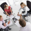Four businesspeople in a boardroom with paperwork — Stock Photo #4767070