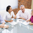 Four businesspeople in boardroom talking — Foto de Stock