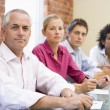 Four businesspeople in boardroom — Foto Stock