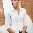 Businesswoman sitting in office space — Stock Photo