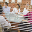 Five businesspeople in boardroom through window — Foto Stock