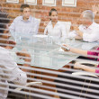 Five businesspeople in boardroom through window — Stock Photo #4767238
