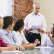 Five businesspeople in boardroom meeting — Stock Photo #4767271