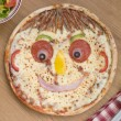 Stock Photo: Smiley Faced Pizzwith Side Salad