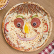 Smiley Faced Pizza with a Portion of Chips — Stock Photo
