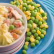 Stock Photo: Individual Fish Pie with Peas and Sweetcorn