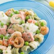 Seafood Pasta Spirals with Peas and Herbs - Stock Photo