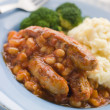 Sausage and Baked Bean Casserole with Mashed Potato and Broccoli - Stock Photo